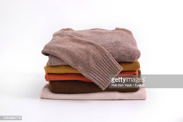 warm clothing on white background - sweater stock pictures, royalty-free photos & images