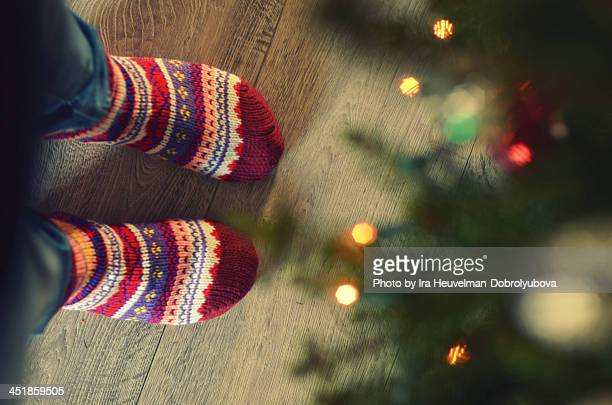 warm cosy socks and christmas tree lights