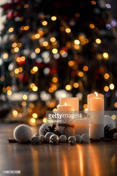 warm decorations for the best season of the year - christmas decore candle stock pictures, royalty-free photos & images