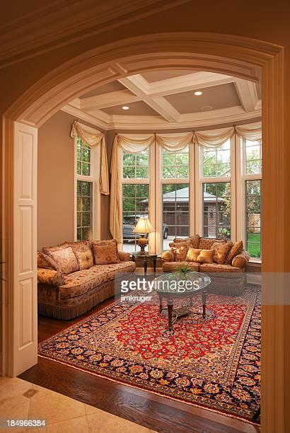Warm elegant formal living room with windows.