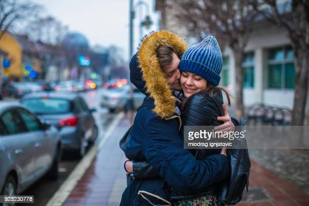 warm embraces on cold rainy day - couples kissing shower stock pictures, royalty-free photos & images