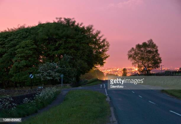 warm evening on country lane, outskirts of sheffield, england - sheffield stock pictures, royalty-free photos & images