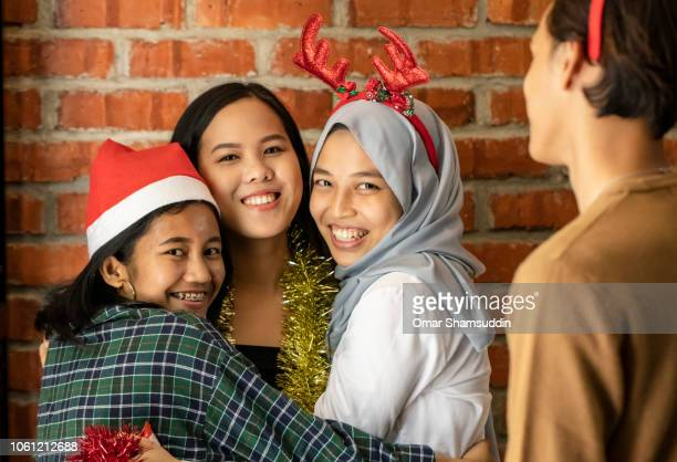 Warm hug with friends on Christmas day