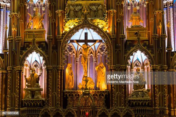 Warm light at altar at Montreal's Notre Dame basilica Catholic church Beautiful colors and architecture of the famous place tourist attraction