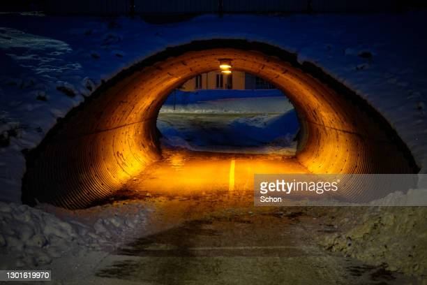 warm light in a subway on a snowy and cold winter evening - vaxjo stock pictures, royalty-free photos & images