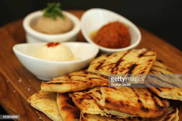 Warm Naan Bread with Three Spreads $12 tuscan white bean honey whipped ricotta and toasted walnut muhamara Dishes at Stephi's in Southie are...