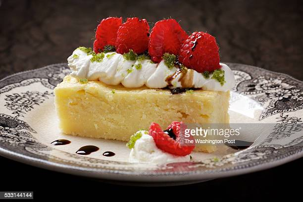 WASHINGTON DC Warm Parmesan Cake With Whipped Mascarpone Raspberries and Basil Sugar photographed in Washington DC Surface courtesy Stone Source of...