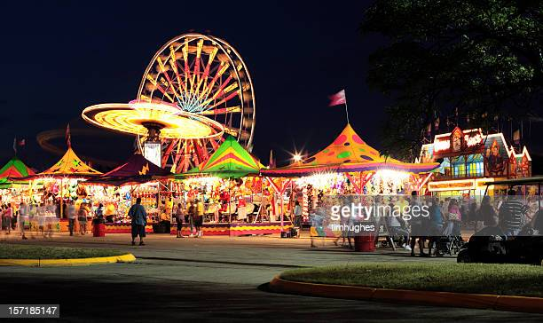warm summer night at the carnival - carnival stock photos and pictures
