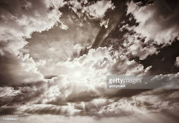 warm sun filtering through clouds - sepia stock pictures, royalty-free photos & images