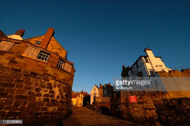 Warm sunlight is reflected from buildings in Robin Hood's Bay on February 26 2019 in Robin Hood's Bay England Warm weather continues to sweep the...