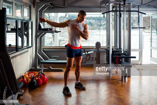 warm up exercise - warming up stock pictures, royalty-free photos & images