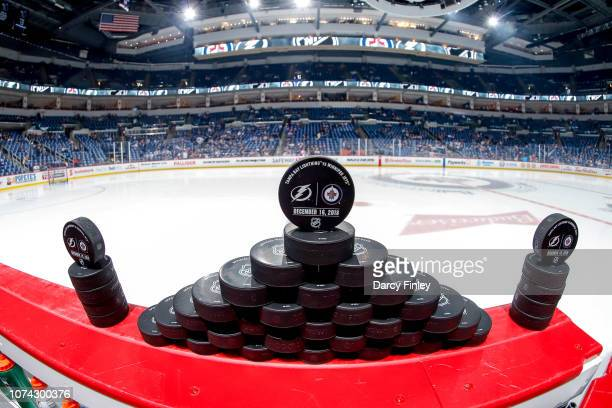 Warm up pucks are lined up and ready for the start of the pregame warm up prior to NHL action between the Winnipeg Jets and the Tampa Bay Lightning...