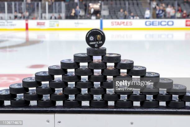 Warm up pucks are stacked awaiting the start of the pregame warm up between the Winnipeg Jets and the Vegas Golden Knights at TMobile Arena on...