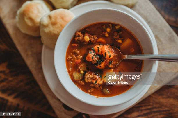 warm vegetable homemade soup dinner - comfort food stock pictures, royalty-free photos & images