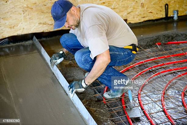 warm water floor,pouring concrete floor - flooring stock photos and pictures