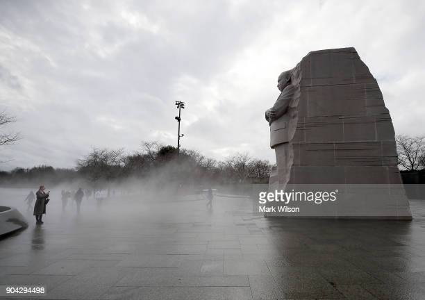 Warm weather causes fog to rise from the ice on the Tidal Basin near the Martin Luther King Jr memorial on January 12 2018 in Washington DC