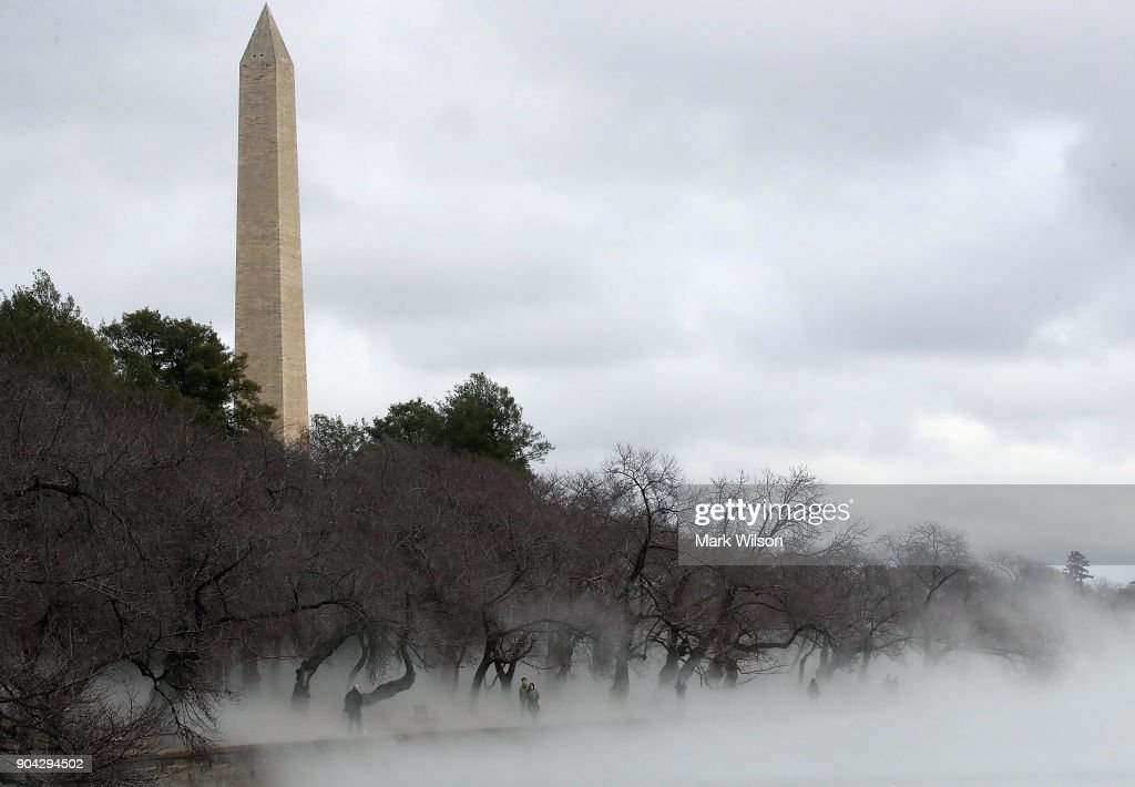 Warm weather causes fog to rise from the ice on the Tidal Basin near the Washington Monument on January 12, 2018 in Washington, DC.