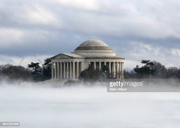 Warm weather causes fog to rise from the ice on the Tidal Basin near the Jefferson Memorial on January 12 2018 in Washington DC
