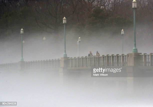 Warm weather causes fog to rise from the ice on the Tidal Basin near the Kutz Bridge on January 12 2018 in Washington DC