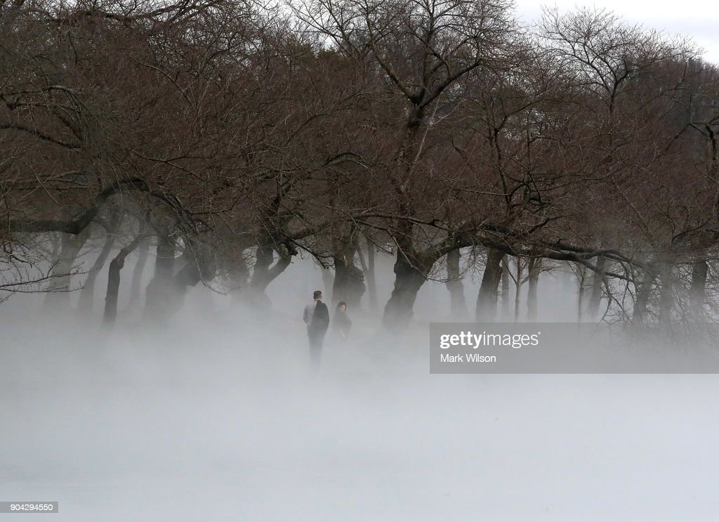 Warm weather causes fog to rise from the ice on the Tidal Basin on January 12, 2018 in Washington, DC.