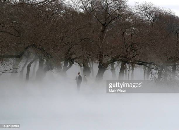Warm weather causes fog to rise from the ice on the Tidal Basin on January 12 2018 in Washington DC