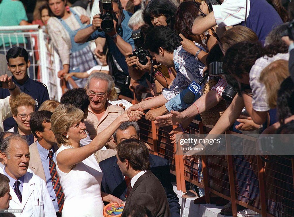 A Warm Welcome For Princess Diana In Argentina At The Start Of Her Visit. Members Of The Crowd Are Stretching Over A Barrier To Shake Her Hand And Take Photographs Of Her.