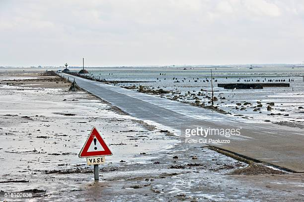 Warming Sign and Low tide of Passage du Gois of Vendée department in west part of France