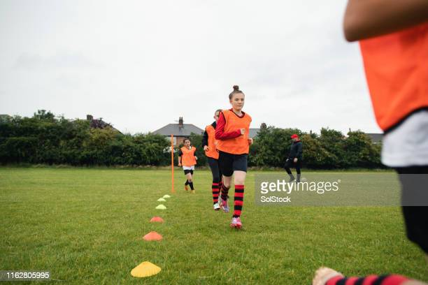 warming up at soccer practice - girls stock pictures, royalty-free photos & images