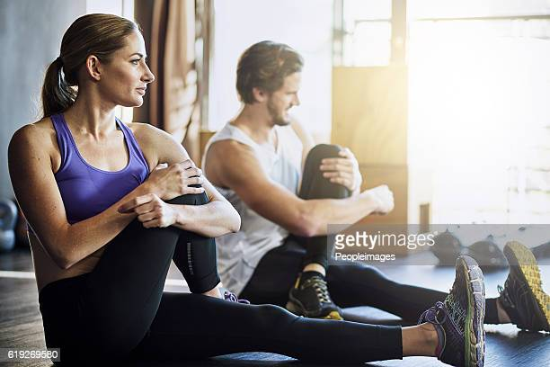 warming up before their workout - warming up stock pictures, royalty-free photos & images