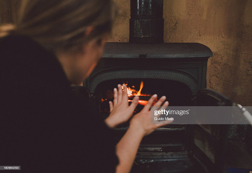 Warming up by the fireside : Stock Photo