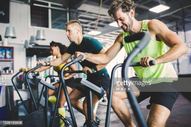 warming up exercising cycling - cardiovascular exercise stock pictures, royalty-free photos & images