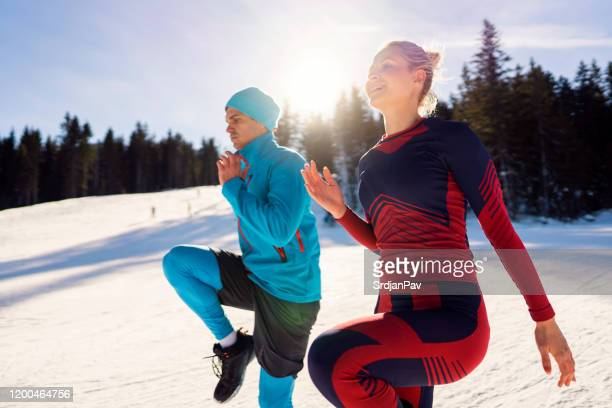 warming up for a day at the snowy slope - warm up exercise stock pictures, royalty-free photos & images
