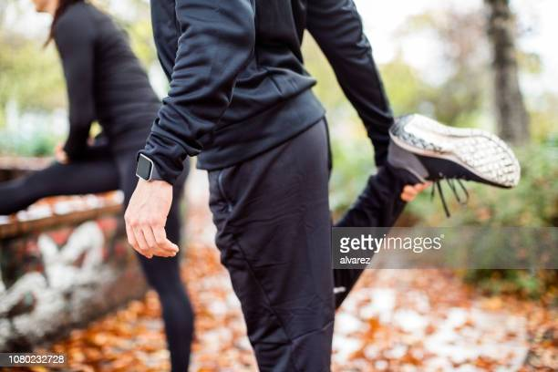 warming up in the park - warming up stock pictures, royalty-free photos & images