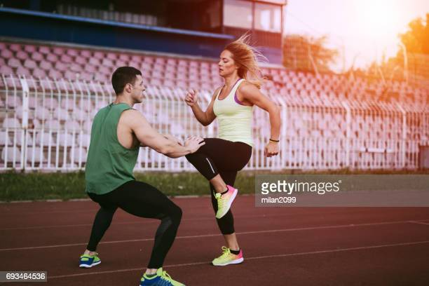 warming up - knees together stock photos and pictures