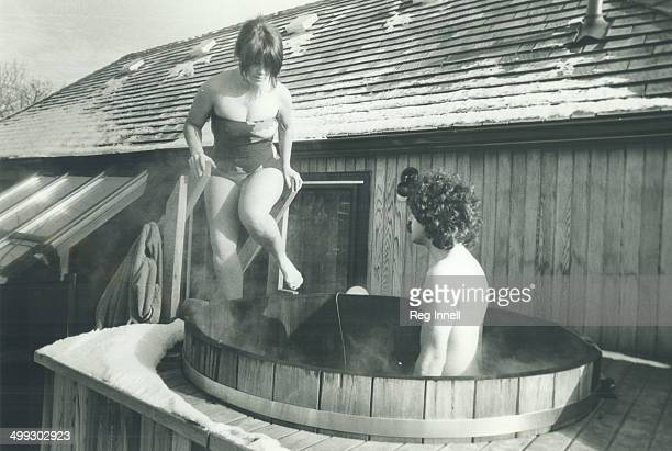 Warming up Reporter Judy Nyman and Harley Mintz in their backyard tub enjoying the hot whirling water and keeping warm while winter temperatures are...
