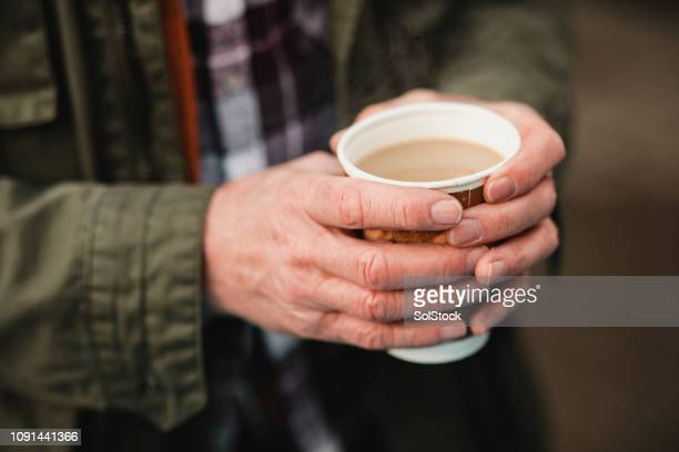 warming up with a coffee - disposable cup stock pictures, royalty-free photos & images