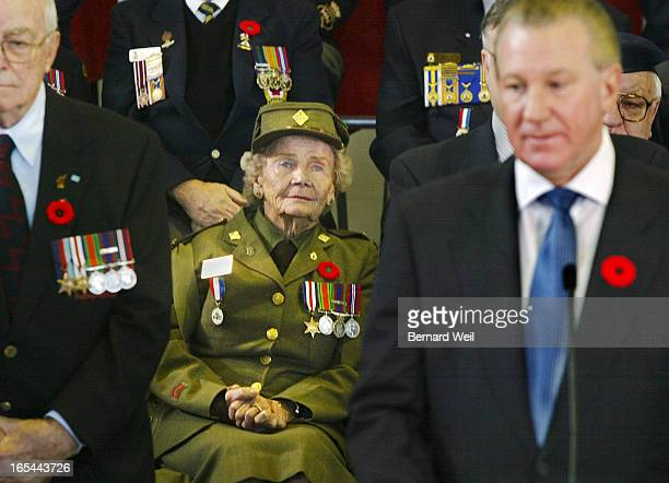 WarMuseum_BW01_110702--Margaret Ackroyd and other war veterans listen to Ontario Premier Ernie Eves announcement that the Ontario government will be...