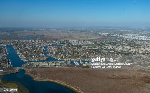 Warner Avenue runs along the southern end of Huntington Harbor then curves as it goes over the Newport-Inglewood fault in Huntington Beach,...