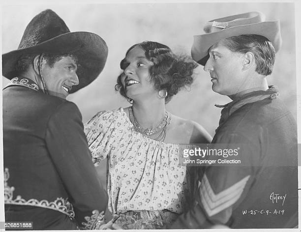Warner Baxter Dorothy Burgess and Edmund Lowe in a promotional photograph for the 1929 film In Old Arizona
