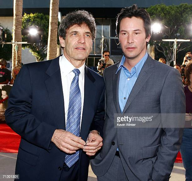 Warner Bros' Alan Horn and actor Keanu Reeves pose at the premiere of Warner Bros Pictures' The Lake House at the Cinerama Dome on June 13 2006 in...