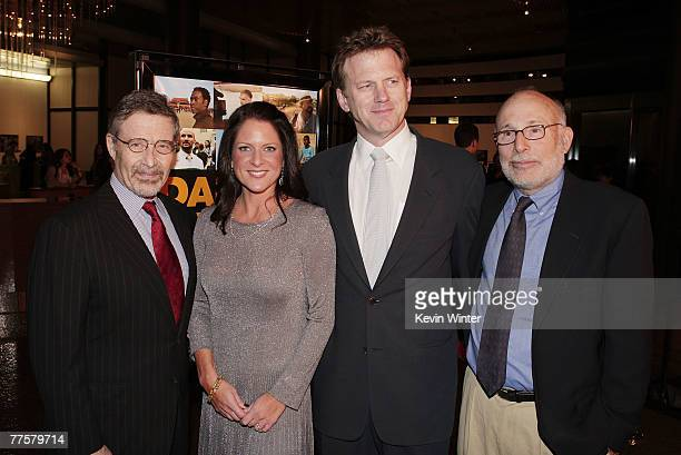 Warner Bros Barry Meyer producer Cathy Schulman writer/director Ted Braun and producer Mark Jonathan Harris pose at a special preview screening of...