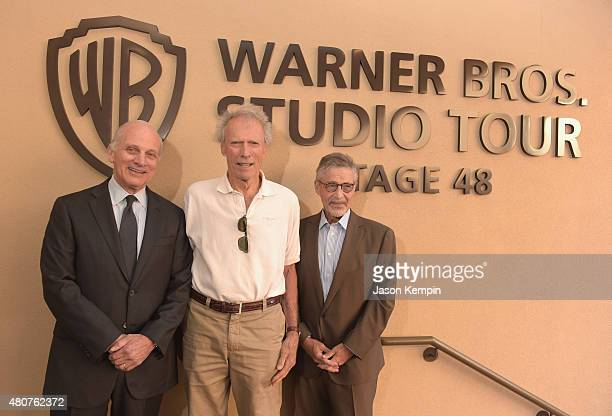 Warner Bros Entertainment Vice Chairman Ed Romano Clint Eastwood and former Warner Bros Chairman CEO Barry Meyer attend the Warner Bros Studio Tour...