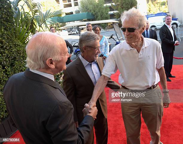 Warner Bros Vice Chairman of Entertainment Ed Romano former Warner Bros Chairman CEO Barry Meyer and Clint Eastwood attend the Warner Bros Studio...