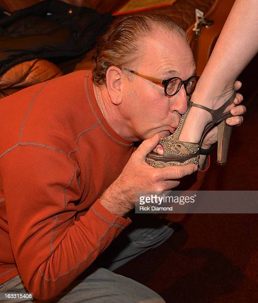 Warner Brothers Nashville John Esposito kisses Ashley Monroe L'AUTRE CHOSE shoe during the Ashley Monroe Album Release Party for Like a Rose at 3rd...