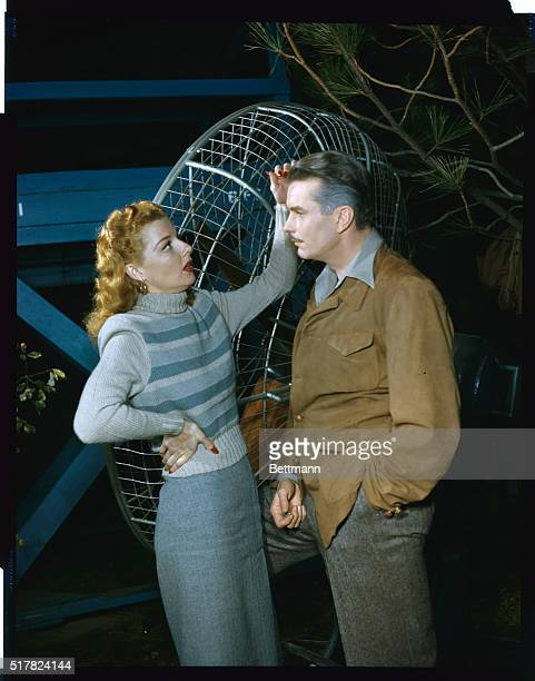 Warner Brothers star Ann Sheridan is the glamorous one smoothing actor Kent Smith's lock's in this between scenes shot on Nora Prentiss set