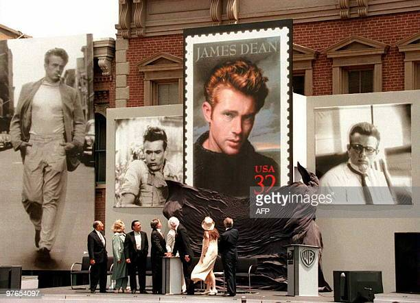 Warner Brothers studio and US Postal Service officials watch as the James Dean stamp is unveiled on the Warner Brother's Midwestern Street studio lot...