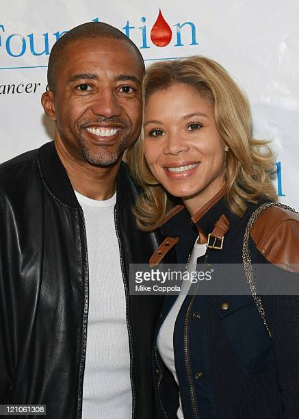 Warner Music Group Executive VP Kevin Liles and Erica Jones attend the 10th annual TJ Martell Foundation Family Day at Roseland Ballroom on March 8...