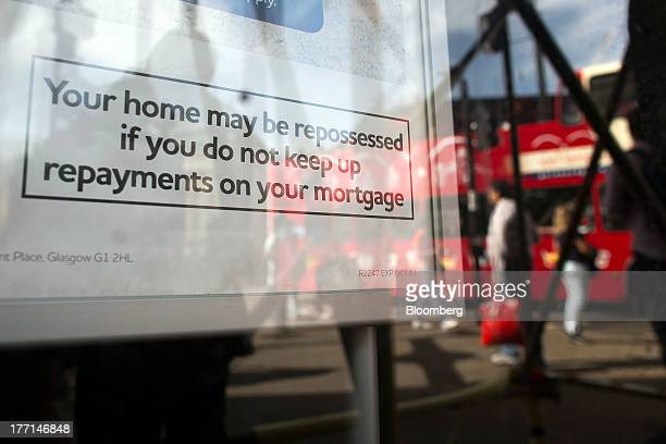 A warning about home repossession sits on advertisement for an interestonly mortgages inside the window of a Clydesdale Bank branch a unit of...