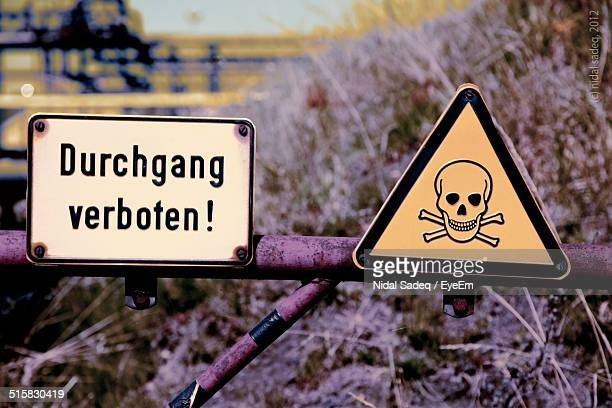 Warning And Danger Signs On Railing
