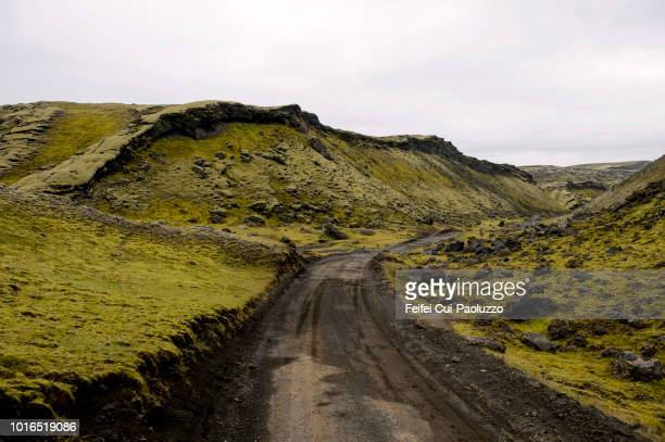 warning and dirt road at eldgja, south of iceland. - lava plain stock pictures, royalty-free photos & images